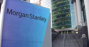 Street signage board with Morgan Stanley Inc. logo. Modern office center skyscraper and stairs background. Editorial 3D. Rendering 4K clip stock video