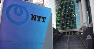 Street signage board with Nippon Telegraph and Telephone Corporation NTT logo Stock Photos