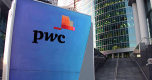 Street signage board with PricewaterhouseCoopers PwC logo. Modern office center skyscraper and stairs background Royalty Free Stock Photos