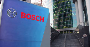 Street signage board with Robert Bosch GmbH logo. Modern office center skyscraper and stairs background. Editorial 3D Stock Image