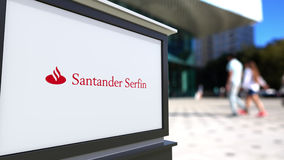 Street signage board with Santander Serfin logo. Blurred office center and walking people background. Editorial 3D Royalty Free Stock Photos