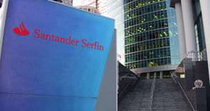Street signage board with Santander Serfin logo. Modern office center skyscraper and stairs background. Editorial 3D Stock Photo