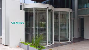 Street signage board with Siemens logo. Modern office building. Editorial 3D rendering Royalty Free Stock Photo