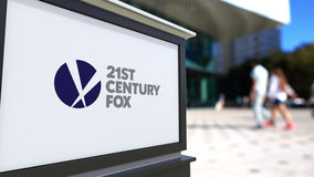 Street signage board with 21st Century Fox logo. Blurred office center and walking people background. Editorial 3D Royalty Free Stock Photo