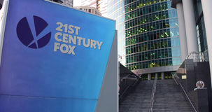 Street signage board with 21st Century Fox logo. Modern office center skyscraper and stairs background. Editorial 3D Stock Images