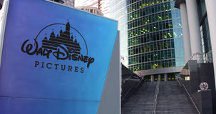 Street signage board with Walt Disney Pictures logo. Modern office center skyscraper and stairs background. Editorial 3D Royalty Free Stock Images