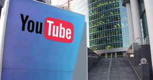 Street signage board with YouTube logo. Modern office center skyscraper and stairs background. Editorial 3D rendering 4K