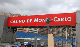 Street, signboard and bronze statue, Monaco, Monte-Carlo. royalty free stock image