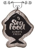 Street signboard for seafood with fish on hook. Vector street signboard or banner for seafood restaurant or shop with the caught fish on the hook, inscription Stock Photography