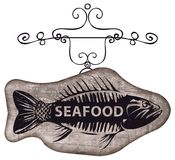 Street signboard for seafood with picture of fish. Vector street sign or banner for seafood restaurant or shop with a picture of fish on a wooden background in Stock Photo