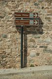 Street signpost indicating public services and city attractions stock image