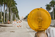 Street signs and barricades. At a public construction site Stock Photos