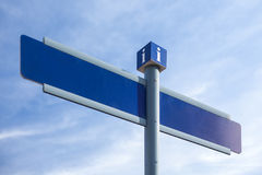 Street sign. Blank blue street signs in the city stock photography