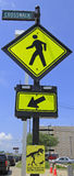 Street signs on Crosswalk Stock Image