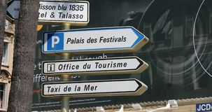 Street Signs With Directions In Cannes France. Cannes, France - May 14, 2019: Street Signs With Directions of `Luxury Hotel`, `Palais des Festivals`, `Office du stock video