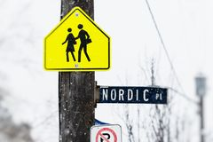 Student crossing nordic place sign. Street signs including student crossing warning sign during winter snowfall Royalty Free Stock Photos