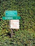 Street signs, Washington, California. Street signs surrounded by foliage. Washington, California royalty free stock photos