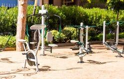 Street simulators in the city park, Salou, Tarragona, Spain. Copy space for text. Stock Photo