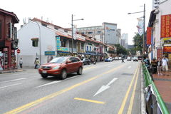 On the street of Singapore. The street and the car with the same tone of Red Cam stand out on the Singapore street, very few motorcycles as well as four wheelers Royalty Free Stock Image