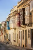 Street of Sliema with traditional maltese colorful balconies. stock photos