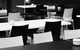 Street small cafe with bw tables and chairs. Royalty Free Stock Photos