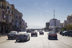 The street of a small Egyptian city with moving cars and low hou Royalty Free Stock Photo