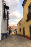 A street on a small town. A colonial street from a small town, pedestrian only street and some houses. This small town is called Malinalco in Estado de México Stock Image