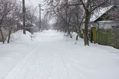 Street of a small Ukrainian village at winter season Stock Images