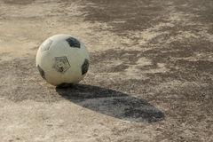 Street soccer ball. Soccer ball with shadow on concrete floor (street soccer Royalty Free Stock Image