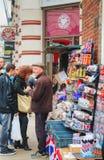 Street souvenir shop in London, UK. LONDON - APRIL 13: Street souvenir shop with tourists on April 13, 2015 in London, UK. London is a popular centre for tourism Stock Photo