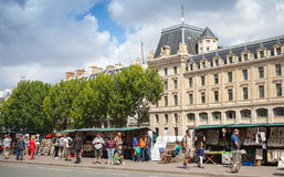 Street souvenir shops with tourists in Paris Royalty Free Stock Photo