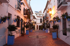 Street in spanish town Estepona. At dusk, Andalusia, Spain Royalty Free Stock Photo