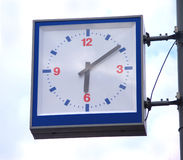 Street square clocks on blue sky with clouds Stock Photos