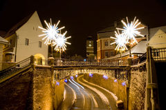 Street square winter snow Christmas New Year. Main street covered with snow by christmas in Sibiu Transylvania Europe Romania with lights and specific decoration Stock Image