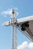 Street stage spotlights on blue sky background. Street stage spotlights on blue clean sky background Royalty Free Stock Photo