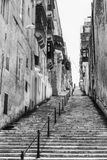 Street with stairs in Valletta. Typical narrow street with stairs on the island of Malta. Buildings with traditional colorful maltese balconies in historical Royalty Free Stock Photos