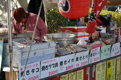 Street Stall. A lady selling grilled snacks in a temple royalty free stock photography