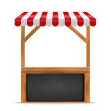 Street stall with red awning and wooden rack. Stock Images