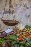 Street stall with vegetables and vintage scales Stock Image