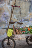 Street stall with vegetables and vintage scales Royalty Free Stock Photos