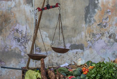 Street stall with vegetables and vintage scales Stock Images