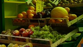Street stalls offering variety of fresh fruit at affordable prices, retail trade. Stock footage stock video footage