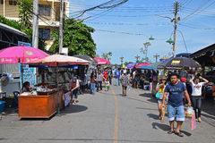 Street Stalls selling mostly food leading to Amphawa Floating Market. Street Stalls with large umbrella selling mostly food delicious local delicacy leading to Royalty Free Stock Images