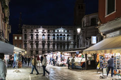 Street stalls of souvenirs in Piazza San Geremia with people browsing. View at dusk Royalty Free Stock Image