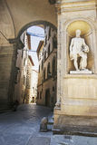 Street with a statue of Benvenuto Cellini in Florence in Italy i Stock Photo