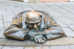 Street statue of Man at Work in Bratislava called Cumil, Slovakia Stock Image
