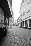 Street of Stavanger, Norway. A narrow street of Stavanger, Norway. Shops and wooden facades. Black and white photo stock images