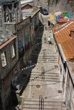 Street with steps and bunting in Porto, Portugal. Exploration, holiday, fun, festive. royalty free stock photo
