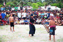 Street stick fight in Kuta , Lombok, Indonesia Royalty Free Stock Images
