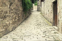 Street of stone. In the photo shown the work of human hands, which are of stone built houses, walls and roads Royalty Free Stock Photo